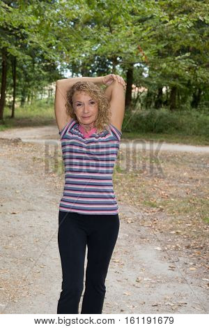 Lovely Fit Senior Woman Making Sport Outdoor