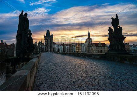 Charles bridge (Karluv most) at dawn. Prague, Czech Republic.