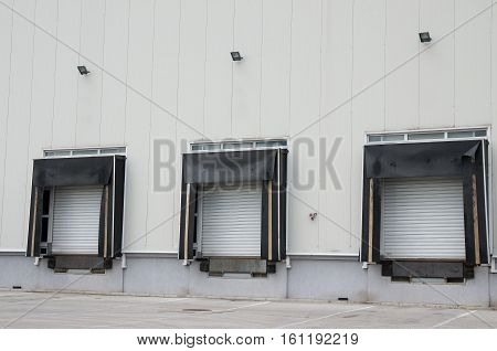Front view of loading docks of warehouse. Loading platform.