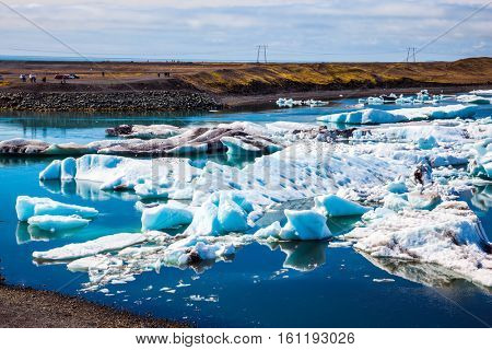 White-blue ice is piled up in turquoise water of the lagoon. Northern nature. The unique nature of Iceland. Drift ice Ice Lagoon - Jokulsarlon