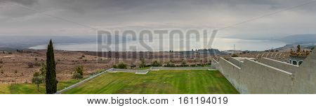 Panoramic view of the Sea of Galilee in winter cloudy day from Domus Galilaeae on the Mount of Beatitudes, Israel