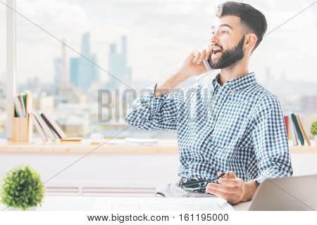Guy At Work Talking On Phone