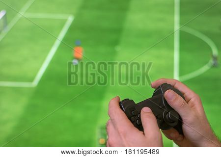 Man Holding Game Controller Joystick While Playing Console Game.