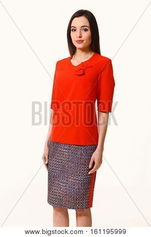 slavic business executive woman with streight hair dress in red blouse and skirt close up photo isolated on white