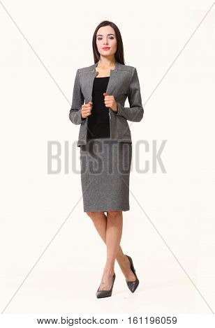 brunette business executive woman with streight hair style in jacket skirt power suit full body photo high-heeled shoes isolated on white