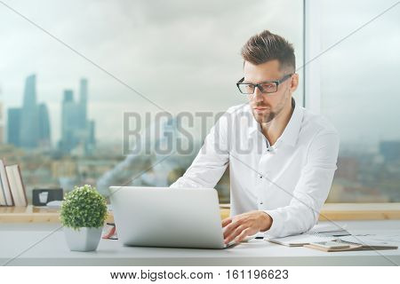 Handsome Businessman Working On Project