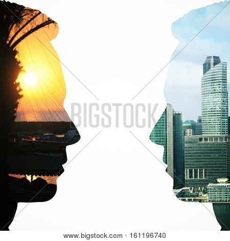 Two male head silhouettes facing each other on city background. Communication concept. Double exposure
