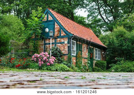 Darmstadt Germany-June 22 2011:Small fairy house with a tiled roof. The house is a workshop for making ceramic products