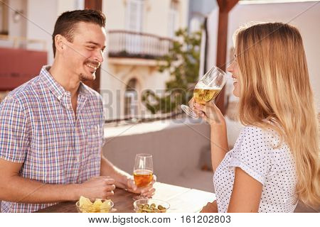 Happily Smiling Couple Having Some Drinks