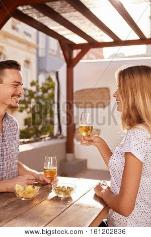 Happily Smiling Young Couple Sharing Drinks