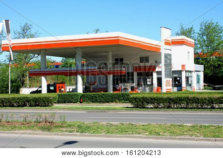 Red and white Gas station for cars and trucks