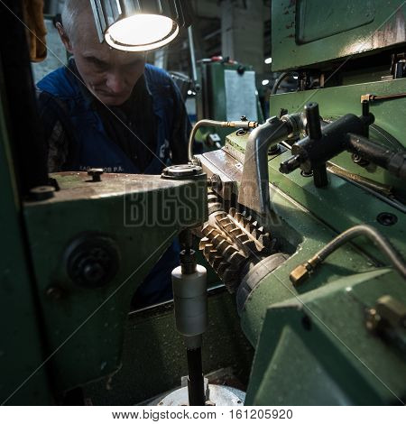 Turner Middle-aged Man Working On A Milling Machine