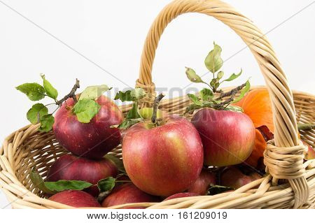 Red Apples In A Big Wooden Basket