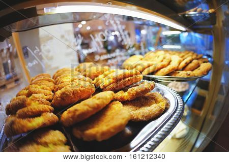 Delicious Sweet Pastries On A Tray In The Windows, The Beautiful Blurred Background With Reflection