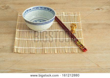 Chines bowl chopsticks and a laughing Buddha