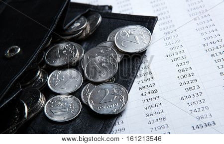 pocket purse with ruble coins on a document with numbers