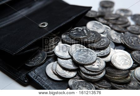 pocket purse with a bunch of Russian coins on a white surface close up