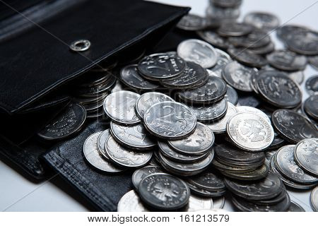 pocket purse with a bunch of Russian coins close up