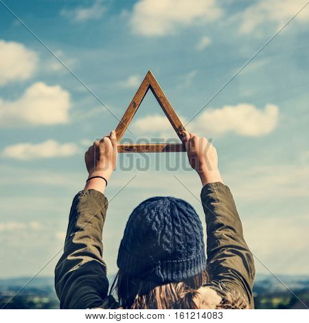 Woman Rear View Holding Triangle Mountain Carefree Cloudscape  Concept