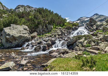 Amazing Landscape with Waterfall near Sivrya peak, Pirin Mountain, Bulgaria