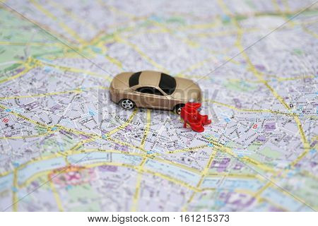Abstract Composition With Small Car And City Map.