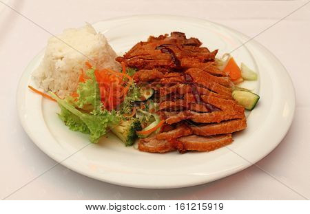 Peking Duck Chop Suey With Steamed Rice Close Up