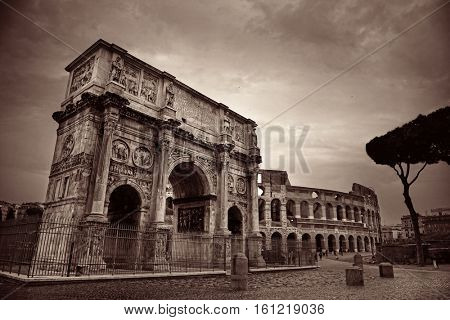 Arch of Constantine and Colosseum in Rome, Italy.