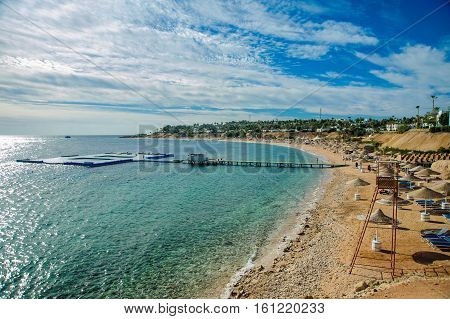 beautiful beach in red sea with green blue azur water and nice blue sky