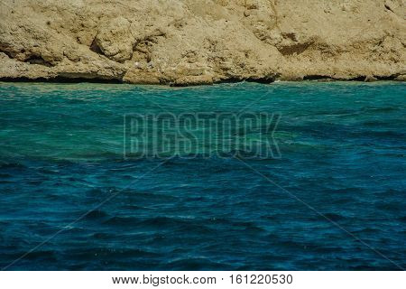 mountains in beautiful turquoise red sea nice beach with gold sand
