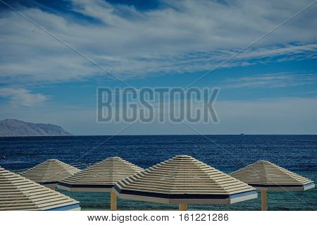 sunshade turquoise sea blue sky beautiful view in tropical location