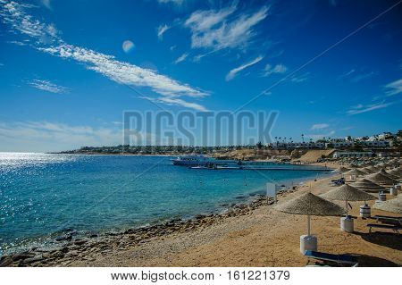 red sea egypt beach sunshade blue sky green water nice view