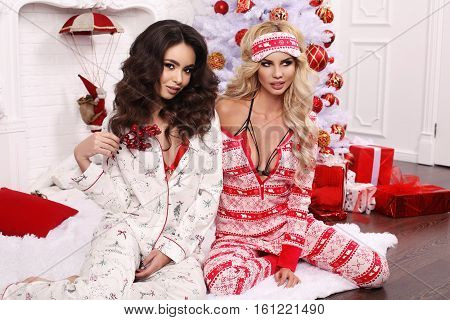 Beautiful Women In Cozy Home Clothes Celebrating New Year Holidays