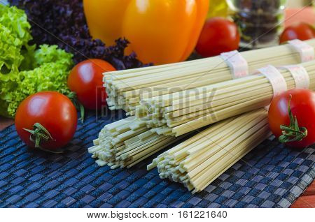 raw udon noodles and vegetables for cooking dishes