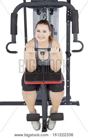 Image of obese young woman exercising and doing weight lifting isolated on white background