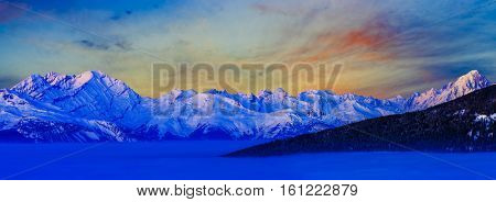 Swiss colorful winter landscape panorama mountains at sunrise, Diableretes and Jungfrau in range, morning fog over the Sion Valley- Swiss Alps, the region Vallis