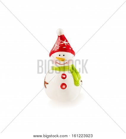 Christmas and New Year's decoration. Funny Snowman figurine made of porcelain isolated over white.
