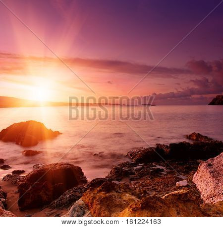 Beautiful colorful sunrise at the sea with dramatic clouds and sun shining. Beauty world natural outdoors travel background