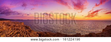 Beautiful colorful sunset at the sea with dramatic clouds. Panoramic view. Beauty world natural outdoors travel background