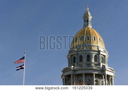 The US and State flags fly at Denver's Capital