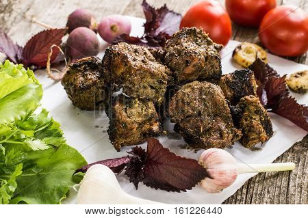 Skewers of lamb cooked on the grill