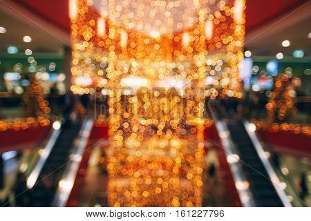 Sparkling background made of lights. Festive blurred backdrop of mall decorated for Christmas