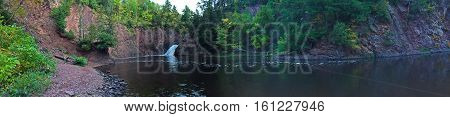 panoramic photograph of a river and waterfall
