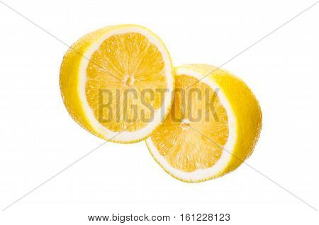 Lemon cut in half on a white background