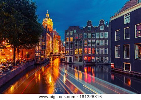 Night city view of Amsterdam canal, bridge and typical houses, Holland, Netherlands. Long exposure. Used toning