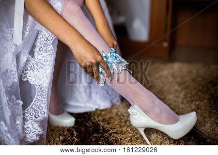 blue garter on leg of the bride morning bride the bride wears a garter on the leg the preparations for the wedding
