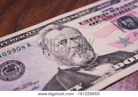 background of the money fifty dollar bills front side. background of dollars close up Portrait of U.S. statesman inventor and diplomat Ulysses S. Grant as he looks on fifty dollar bill obverse face bill of fifty dollars