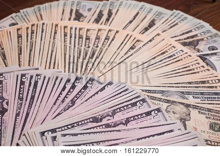 background of the money five ten twenty dollars bills front side face. background of dollars five ten twenty dollars bills fan fan of money