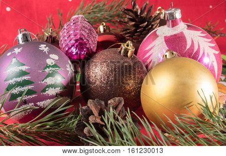 Multicolored Christmas balls and pine cone. Christmas background