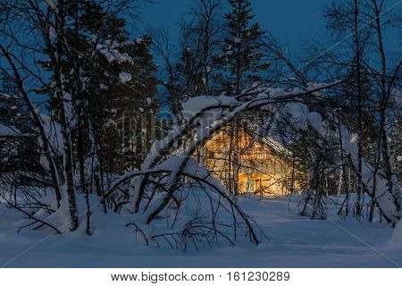 Winter cold night Landscape, small wooden house with warm light, a lot of snow, rural scene