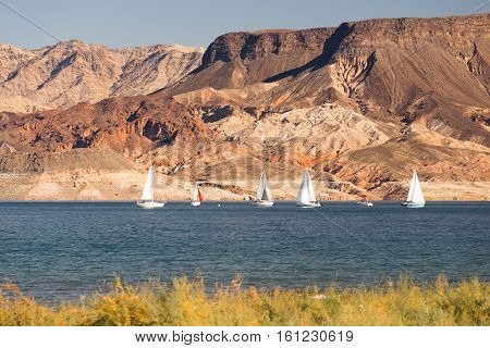 Mountains dominate the background with Sailboats moving along Lake Mead